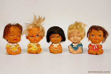 little girl dolls with various facial expressions