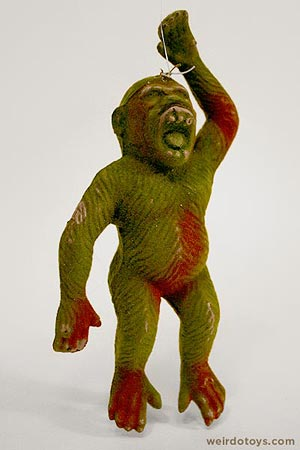 Weird, dingy green monkey toy